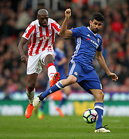 Chelsea's Diego Costal battles with Stoke City's Bruno Martins Indi<br /> <br /> Photographer Mick Walker/CameraSport<br /> <br /> The Premier League - Stoke City v Chelsea - Saturday 18th March 2017 - bet365 Stadium - Stoke<br /> <br /> World Copyright &copy; 2017 CameraSport. All rights reserved. 43 Linden Ave. Countesthorpe. Leicester. England. LE8 5PG - Tel: +44 (0) 116 277 4147 - admin@camerasport.com - www.camerasport.com