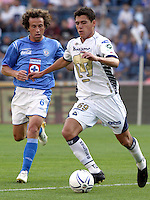Mexico (18.02.2006) UNAM Pumas defender Hector Moreno (R) drives the ball as the  Cruz Azul midfielder Gerardo Torrado tries to get it during their soccer match at the Blue Stadium in Mexico City, February 18, 2006. Cruz Azul won 3-1 to UNAM.  © Photo by Javier Rodriguez/