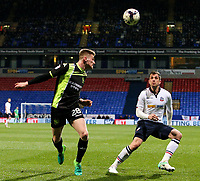 Bury's Taylor Moore heads clear of Bolton Wanderers' Andrew Taylor<br /> <br /> Photographer Alex Dodd/CameraSport<br /> <br /> The EFL Sky Bet League One - Bolton Wanderers v Bury - Tuesday 18th April 2017 - Macron Stadium - Bolton<br /> <br /> World Copyright &copy; 2017 CameraSport. All rights reserved. 43 Linden Ave. Countesthorpe. Leicester. England. LE8 5PG - Tel: +44 (0) 116 277 4147 - admin@camerasport.com - www.camerasport.com