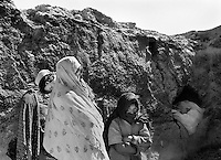 Children of some of the widows who live in the ruined village of Aqrabat, Aghanistan on Thursday, June 27, 2002. The men were all killed when the families had to flee the Taliban attack on her home village of Saighan in 2001. 46 ethnic Hazara widows and their children live in Aqrabat. More than six million people fled Afghanistan during the years of conflict following the Soviet invasion in 1979.