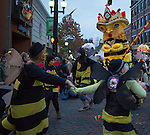 Participants dressed like bees in the Honey for the Heart parade circle around the queen bee at the intersection of Court Street and Washington Street during the Honey for the Heart parade on October 31, 2015. Photo by Emily Matthews