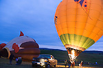 """Hot air balloonists  at the Shenandoah Valley Hot Air Balloon Festival at Historic Long Branch in Millwood, Virginia fire a propane burner to heat the air in the balloon """"envelope"""" to keep the balloon upright.  Since hot air rises, this causes the balloon to stand up, and eventually fly."""