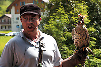 Liechtenstein  Malbun  June 2008.Small town high in the Alpine (southeastern)..Falconry Center.The falconer Norman  Vogeli with the predatory  .www.galina.li...