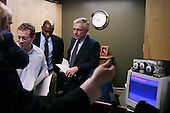 Phoenix, Arizona.USA.January 28, 2004..General Wesley Clark, moments before addressing a crowd of supporters, consults with his staff and local officals back stage.