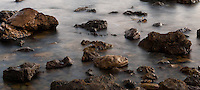 Water turns into a silky smooth sheen in a long-exposure shot of the rocky intertidal at Little Corona Beach in Corona Del Mar (Newport Beach), CA.