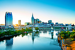 The skyline of Nashville, Tennessee and the Cumberland River at sunrise.
