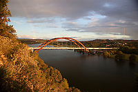 A Rainbow overlooks the 360  Bridge (Pennybacker Bridge) surrounding hills and lake austin, Texas, USA