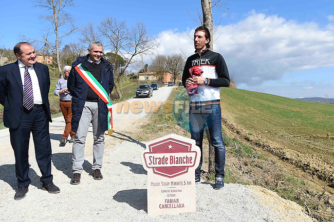 Monte Santa Maria gravel sector dedicated to 3 time winner Fabian Cancellara today pictured with Mauro Vegni, RCS Sport Cycling Director, and the Major of Asciano, Paolo Bonari, Asciano, Tuscany, Italy 3rd March 2017.<br /> Picture: LaPresse | Newsfile<br /> <br /> <br /> All photos usage must carry mandatory copyright credit (&copy; Newsfile | LaPresse)