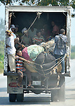 People ride a truck out of Port-au-Prince, Haiti, which was devastated by a January 12 earthquake. Tens of thousands of capital city residents are reportedly fleeing to the countryside.