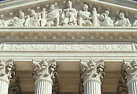 US Supreme Court   Washington DC<br /> The Supreme Court building, located on Capitol Hill in Washington DC,  is the seat of the Supreme Court of the United States. It is situated in Washington, D.C one block east of the United States Capitol.  Architectural detail of the west fa&ccedil;ade includes striking columns and bears the motto &quot;Equal Justice Under Law,&quot;.  A national icon and popular tourist attraction in Washington DC.