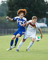 Winthrop University Eagles vs the Brevard College Tornados at Eagle's Field in Rock Hill, SC.  The Eagles beat the Tornados 6-0.  Magnus Thorsson (8) moves away from a challenge by Augusto Isern (18).