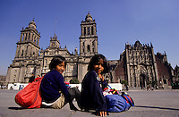 Two young girls selling souvenir on The Plaza de la Constitucion in front of the metropolitan cathedral in Mexico city