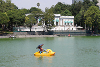 Paddle boat in front of the Casa del Lago on Lago de Chapultepec in the First Section of Chapultepec Park, Mexico City