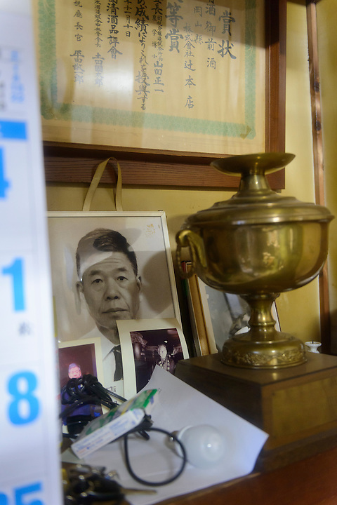 """A photograph of former """"toji"""" master brewer Harada-san. Tsuji Honten Sake, Katsuyama town, Okayama Prefecture, Japan, February 1, 2014. Tsuji Honten was founded in 1804 and has been at the cultural centre of the town of Katsuyama for over two centuries. 34-year-old Tsuji Soichiro is the 7th generation brewery owner. His elder sister, Tsuji Maiko, is the """"toji"""" master brewer."""