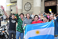 Faithful people show their joy infront Buenos Aires Cathedarl  after the news that newly elected Pope is cardinal of Argitina Jorge Bergoglio, now  Francis I,  March 13, 2013 in Vatican City, Vatican.