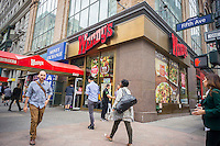 A busy Wendy's fast food restaurant in New York on Wednesday, May 6, 2015. Wendy's announced that it will sell 640 company owned stores to franchisees. The sales, which McDonald's is doing also, generates cash and reduces expenses for the company. (© Richard B. Levine)