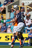 Jack Smith, Millwall FC heads clear under pressure - Millwall vs Blackpool - NPower Championship Football at the New Den, London - 18/08/12 - MANDATORY CREDIT: Ray Lawrence/TGSPHOTO - Self billing applies where appropriate - 0845 094 6026 - contact@tgsphoto.co.uk - NO UNPAID USE.