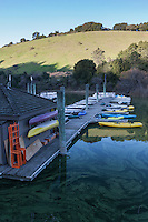Colorful canoes and kayaks await adventurous visitors to the marina at Lake Chabot Regional Park in the hills east of San Francisco Bay.