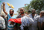 A relative carry the body of 18-month-old Palestinian baby Ali Dawabsheh, who was killed after his family's house was set on fire in a suspected attack by Jewish extremists, during his funeral in Duma village near the West Bank city of Nablus July 31, 2015. Suspected Jewish attackers torched a Palestinian home in the occupied West Bank on Friday, killing an 18-month-old toddler and seriously injuring three other family members, an act that Israel's prime minister described as terrorism. Photo by Ahmad Talat