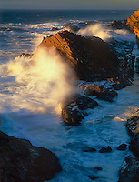 769550431 sunset turns portions of the sea stacks along the oregon coastline of the pacific ocean a golden hue in shore acres state park