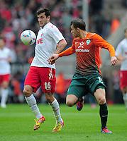FUSSBALL   1. BUNDESLIGA   SAISON 2011/2012   29. SPIELTAG 1. FC Koeln - SV Werder Bremen                           07.04.2012 Mikael Ishak (li, 1. FC Koeln) gegen Lukas Schmitz (re, SV Werder Bremen)