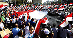 Protesters opposing Egyptian President Mohamed Mursi carry a huge flag as they march to Tahrir square from Mustafa Mahmoud mosque  in Cairo June 30, 2013. Mass demonstrations across Egypt on Sunday may determine its future, two and half years after people power toppled a dictator they called Pharaoh and ushered in a democracy crippled by bitter divisions. Photo by Ahmed Asad