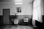 Sumguyit, Azerbaijan<br /> December  10, 2006<br /> <br /> The main office with a photo of the former Azeri President Heydar Aliev in the entrance way. This is part of an of a massive old chemical factory, now mostly abandoned, was once one of the most polluted factories in all of the Soviet Union.