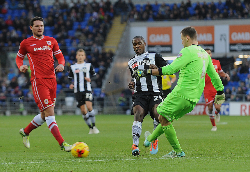 Cardiff City's David Marshall clears the danger from the chasing Watford's Odion Ighalo<br /> <br /> Photographer Ian Cook/CameraSport<br /> <br /> Football - The Football League Sky Bet Championship - Cardiff City v Watford - Saturday 28th December - Cardiff City Stadium - Cardiff<br /> <br /> &copy; CameraSport - 43 Linden Ave. Countesthorpe. Leicester. England. LE8 5PG - Tel: +44 (0) 116 277 4147 - admin@camerasport.com - www.camerasport.com