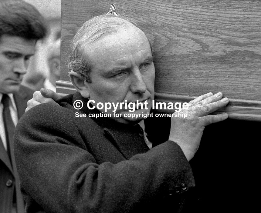 Irish Justice Minister, Patrick Cooney, carrying coffin at the funeral of Senator Billy Fox, 35 years, Protestant, Fine Gael politician, Co Monaghan, Rep of Ireland, 14th March 1974. He was previously a TD (Irish MP).  Fox was visiting the home near Clones of his fiancee, Marjorie Coulson, which unknown to him had been taken over by thirteen armed paramilitaries. He ran from the scene but was followed and shot dead in a nearby field. Five members of the Provisional IRA were subsequently tried and convicted of the killing. 197403140164d. .Copyright Image from Victor Patterson, 54 Dorchester Park, Belfast, United Kingdom, UK...For my Terms and Conditions of Use go to http://www.victorpatterson.com/Victor_Patterson/Terms_%26_Conditions.html