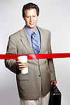 A business man at finish line or facing red tape