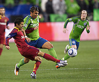 Real Salt Lake Javier Morales, left and Seattle Sounders FC forward Sammy Ochoa battle for the ball during play in a Major League Soccer Wester Conference Semifinal match at CenturyLink Field in Seattle Wednesday November 2, 2011. The Sounders won the match 2-0, but lost the series.