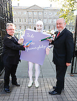 NO REPRO FEE. 18/10/2011. Cross partyTDs  to put aside party differences for Alzheimers. Cross party elected officials will join forces with a giant purple post it character outside the gates of Dail Eireann to remind elected officials to sign up to the Alzheimer Pledge to bring in a National Dementia Strategy for Ireland. Pictured are Sean O Fhearghaill Fina Fail and Caomghin O Caolin Sinn Fein spokesperson on health. Picture James Horan/Collins Photos