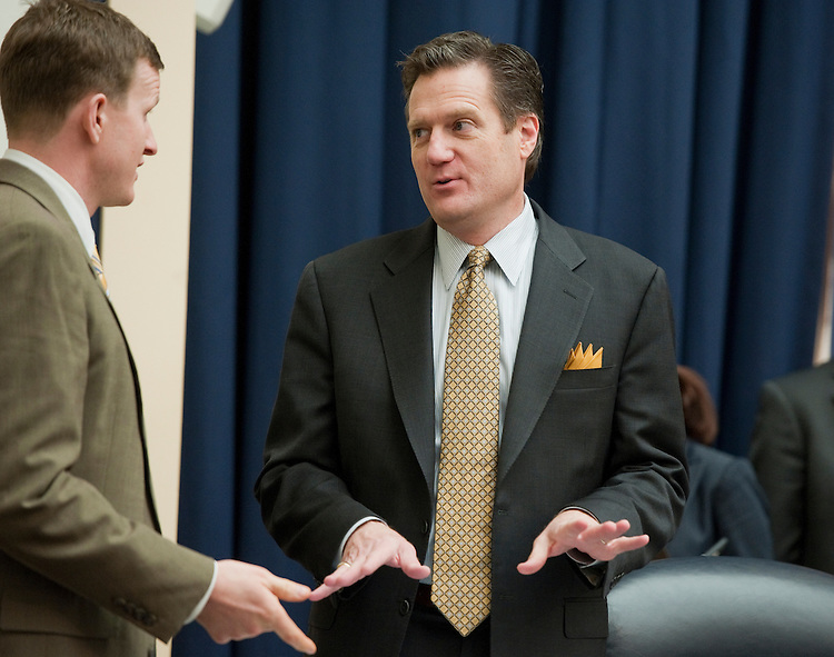 """UNITED STATES - MARCH 01:  Rep. Mike Turner, R-Ohio, center, talks with an aide before a House Armed Services Committee hearing in Rayburn entitled """"FY2013 National Defense Authorization Budget Request from U.S. Pacific Command."""" (Photo By Tom Williams/CQ Roll Call)"""