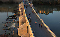 The Roman bridge, built 1st century BC over the Guadalquivir river, and (right) the reflection of the Cathedral-Great Mosque of Cordoba, in Cordoba, Andalusia, Southern Spain. The first church built here by the Visigoths in the 7th century was split in half by the Moors, becoming half church, half mosque. In 784, the Great Mosque of Cordoba was built in its place, but in 1236 it was converted into a catholic church, with a Renaissance cathedral nave built in the 16th century. The historic centre of Cordoba is listed as a UNESCO World Heritage Site. Picture by Manuel Cohen