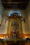 Mission San Juan Bautista, Crucifix at side entrace; candles