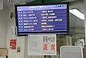 March 17, 2011, Tokyo, Japan - Announcements in the highway bus terminal in Shinjuku, Tokyo, tell potential passengers that either approximately half of the routes have been cancelled or all seats to Sendai and the northern part of Japan are fully booked through March 22, 2011. Service from March 23 is yet to be determined. (Photo by Atsushi Tomura/AFLO)