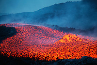 Lava flow with boulder rolling in it, Mount Etna Volcano 2006 Stratovolcano, Sicily Island, Italy