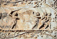 Bas-relief sculpture panel scene of Eve and Adam being driven out of the Garden of Eden made by Maitani around 1310 on the14th century Tuscan Gothic style facade of the Cathedral of Orvieto, Umbria, Italy