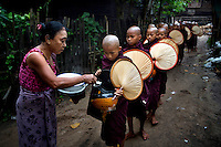 Monks from the Myazeda Man Oo Monastery, where they produce promotional material and literature for the Buddhist nationalist 969 movement, go on their rounds to collect morning alms in Mawlamyine, Mon State. /Felix Features