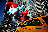 USA, New York, Nov 28, 2013. The Papa Smurf balloon floats while people take part in the 87th Macy's Thanksgiving Day Parade in New York City. Photo by VIEWpress/Eduardo Munoz Alvarez