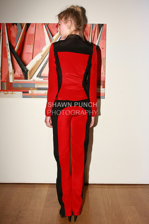 Model poses in a silk crepe two-toned bow jacket with pants, for the Yuna Yang Pretty to Think So, Resort 2012 collection, on June 17, 2011.