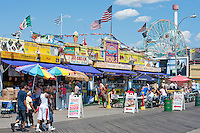 the boardwalk at coney island during the summer