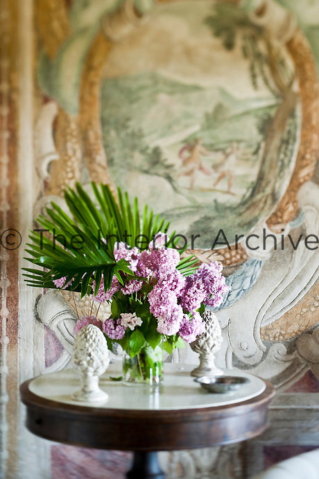 A flower composition with freshly cut hydrangeas backed by a paml leaf