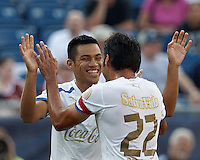 C.D. Olimpia midfielder Jose Escalante (12) celebrates his goal with teammate. In an international friendly, AC Milan defeated C.D. Olimpia, 3-1, at Gillette Stadium on August 4, 2012.