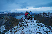 Two hikers on summit of Persatind, Gimsøy, Lofoten Islands, Norway