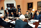 United States President Ronald Reagan meets with the U.S. - Japan Advisory Committee in the Roosevelt Room of the White House on Wednesday, June 22, 1983.  Participating in the meeting are Clockwise from right: Nobuhiko Ushiba, President Reagan, James Hodgson, Isamu Yamashita, Daryl Arnold, Akio Morita, Executive Director Albert Seligmann, and David Packard..Mandatory Credit: Jack Kightlinger - White House via CNP