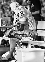 Raider John Matuszak sitting on bench during the 1977 Superbowl game against the Minnesota Vikings..<br />