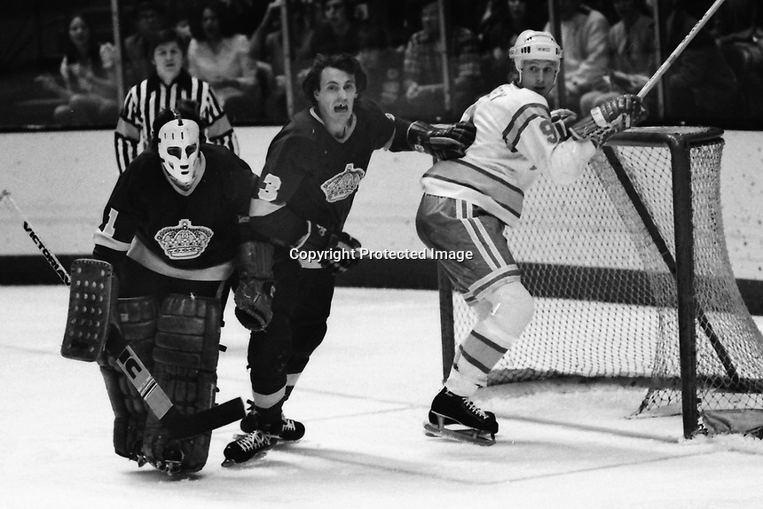 Seals vs Los Angeles Kings 1975..LA goalieGary Edwards and Larry Brown defend. Seals Larry Patey. (photo/Ron Riesterer)