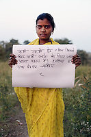 Ramila Mandoriya - 28 yrs.Madhya Pradesh.Hindu.Works in a food fortification centre.Mother of three children..Hindi - 'Sometimes we have to travel 3 km's to and fro to get water. I want a hand pump'.