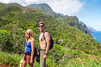A couple hiking the Kalalau Trail on Kaua'i.